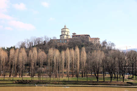 A view from the Po riverbank of Santa Maria del Monte church in Turin, Italy