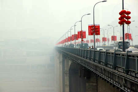 A view of the Bridge Shibanpo over the Yangtze river on March 15, 2012 in Chongqing  The Shibanpo bridge was built from 1977 to 1980 and is 330 meters long  Banco de Imagens