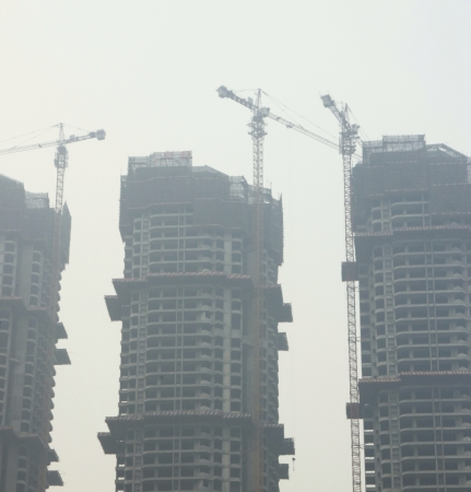 Chongqing, China, March 15, 2012 - Three buildings under construction.