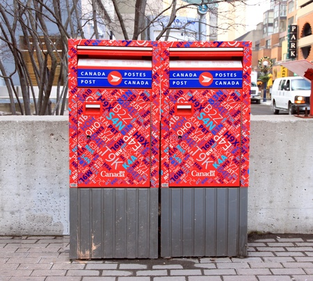 Toronto, Canada, November 24, 2011 - Two Canada Post mailboxes in a street.