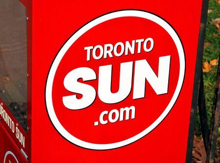 Toronto, Canada, November 24, 2011 - The Toronto Sun logo on a newspaper vending machine.
