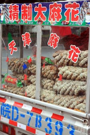 Chongqing, China, March 18, 2012 - A cart selling Chinese street food in Chongqing. Redakční