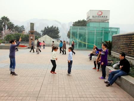 Chongqing, China, March 18, 2012 - Kids playing in a street of Chongqing.