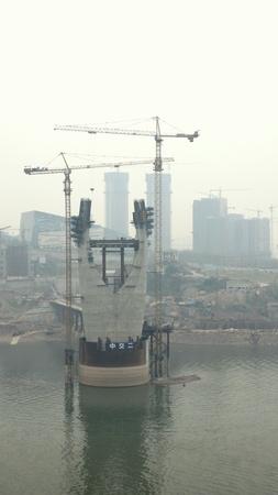 Chongqing, China, March 18, 2012 - A bridge under construction on the Yangtze River, in Chongqing