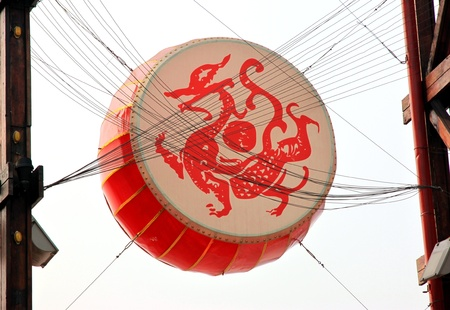 chinese drum: Chongqing, China, March 18, 2012 - A large Chinese drum above a square in Chongqing. Editorial