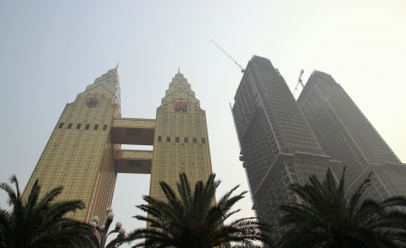 Chongqing, China, March 18, 2012 - The Sheraton towers and two buildings under construction in Chongqing.