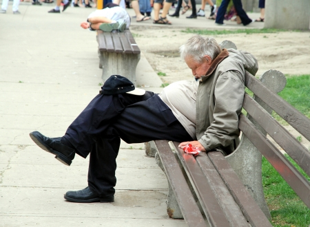 Toronto, Canada, May 27, 2012 - A man is sleeping on a bench in Toronto.