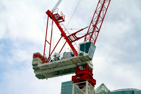 A crane working on a new building in Downtown Toronto. Editorial