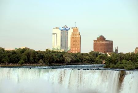 seneca: Niagara Falls, Canada, June 30, 2012 - A view of the U.S. side of the Niagara Falls and the Seeca Niagara Casino building Editorial