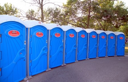 Toronto, Canada, July 7, 2012 - A line of portable toilets at an outdoor event 報道画像