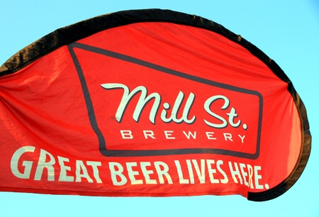 brewery: Toronto, Canada, July 7, 2012 - A Mill St. Brewery ad at an outdoor event Editorial