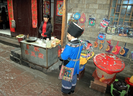 miao: Fenghuang, China, March 23, 2012 - Miao minority women in a street of Fenghuang, China