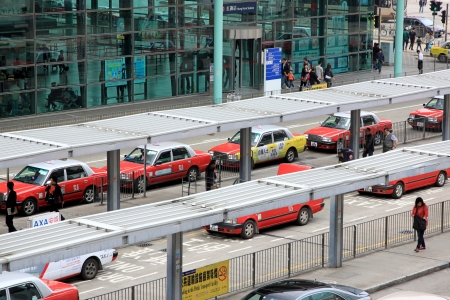 Hong Kong, March 31, 2012 - A line of red taxis in Hong Kong