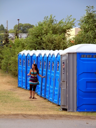 Toronto, Canada, July 22, 2012 - A line of portable toilets at an outdoor event