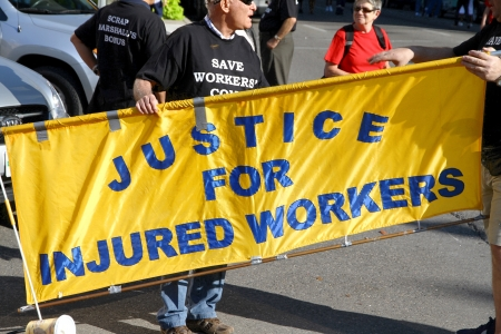 Toronto, Canada, September 3, 2012 - A banner supporting justice for injured workers at the 2012 Toronto Labor Day Parade Stock Photo - 15240205