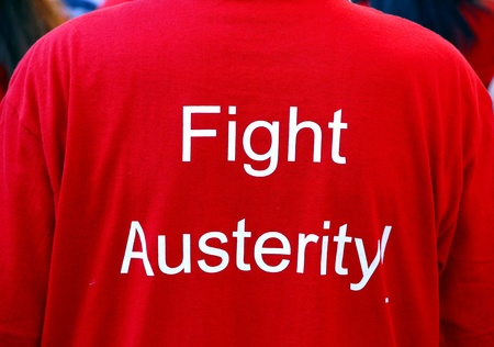 mob: A red Fight Austerity t-shirt at the annual Toronto Labor Day Parade Stock Photo