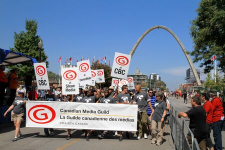 cbc: Toronto, Canada, September 3, 2012 - Media employees marching at the annual Labor Day Parade in Toronto