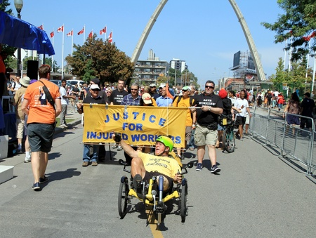 Toronto, Canada, September 3, 2012 - A group of unionized workers supporting injured workers at the Labor Day Parade in Toronto Stock Photo - 15453018