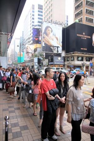 Hong Kong, April 3, 2012 - People queuing outside a clothing store in Hong Kong Editorial