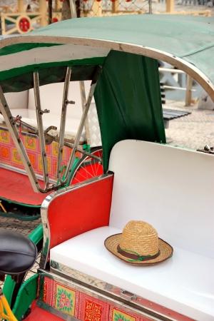 trishaw: A rickshaw in a street in Macau