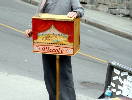 Quebec City, Canada, September 9, 2012 - A man playing a street organ