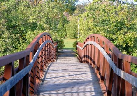 suburban: A pedestrian wooden bridge in a suburban area