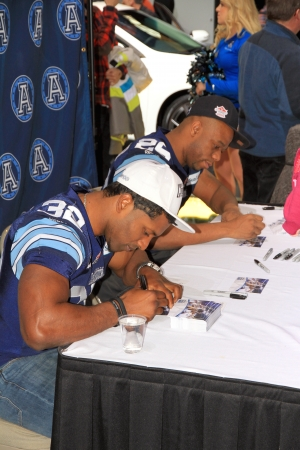 Toronto, Canada, February 15, 2013 - Toronto Argonauts players signing autographs at the 2013 Canadian International AutoShow in Toronto Editorial