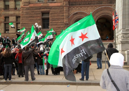 assad: TORONTO - MARCH 16: Syrian demonstrators on March 16, 2013 in Toronto. Since March 2011, Syria has been embroiled in civil war in the wake of uprisings against Assad and the neo-Ba\ Editorial