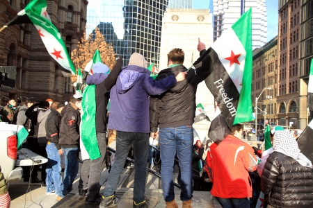 assad: TORONTO - MARCH 16: Syrian demonstrators on March 16, 2013 in Toronto. Since March 2011, Syria has been embroiled in civil war in the wake of uprisings against Assad