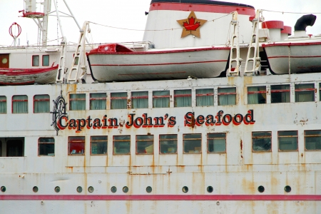 TORONTO - APRIL 9: Captain Johns Seafood restaurant on April 9, 2013 in Toronto. Captain Johns Harbour Boat Restaurant is a noted restaurant and banquet hall in Toronto.