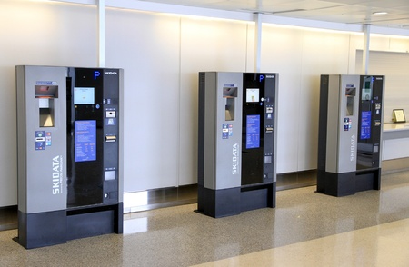 payable: TORONTO - MAY 10: Automatic parking machines at Pearson Airport on May 10, 2013 in Toronto. In 2012, Pearson Airport handled 34,912,456 passengers and 433,990 aircraft movements. Editorial