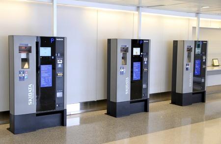 TORONTO - MAY 10: Automatic parking machines at Pearson Airport on May 10, 2013 in Toronto. In 2012, Pearson Airport handled 34,912,456 passengers and 433,990 aircraft movements. Editorial
