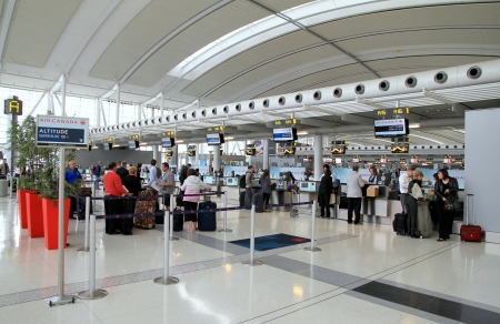 TORONTO - MAY 10: Passengers waiting to check-in on May 10, 2013 in Toronto. Pearson is the largest and busiest airport in Canada, and is one of the world\'s largest air transportation hubs.