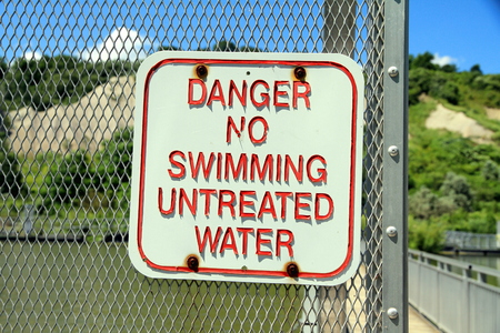 Danger No Swimming Untreated Water sign Stock Photo