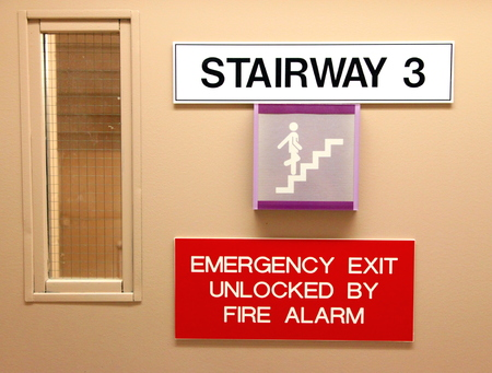 Signs indicating a stairway in a hospital photo