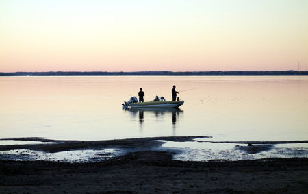 Men fishing in the Lake Ontario on October 12, 2013 in Picton, Canada