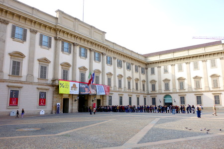 MILAN, ITALY - APRIL 12, 2014  People lining up at the Palazzo Reale entrance in Milan  The Royal Palace was the seat of Milan s government for many centuries but today is an important cultural centre