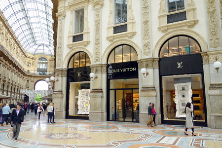 MILAN, ITALY - APRIL 12, 2014  Galleria Vittorio Emanuele s Louis Vuitton store in Milan  The Galleria was designed and built by Giuseppe Mengoni between 1865 and 1877