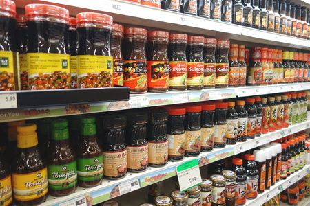 Mixed spice products on supermarket shelf in Toronto, Canada