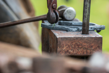 farriery: A concept photo of blacksmithing, these tools are owned by a skilled blacksmithfarrier.
