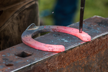 farriery: a horseshoe being crafted by a skilled blacksmithfarrier. Stock Photo