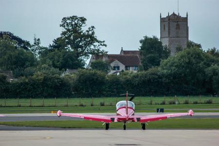 civilian: stunt civilian plane preparing to take off Editorial
