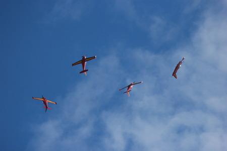 civilian: stunt civilian planes flying in synchronization.