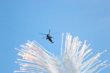 deterrence: military helicopters used by the British Royal Navy setting off missile deterrence flares