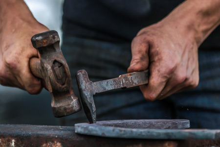 farriery: Horse shoe being made by blacksmith Stock Photo
