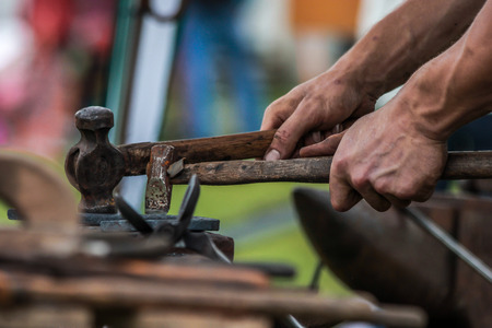 farriery: A shot of a horseshoe being crafted by a skilled blacksmithfarrier. Stock Photo