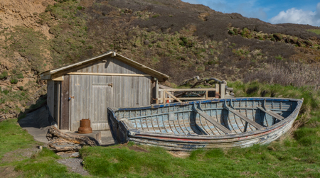 boat house: A adelic boat house with old boat outside