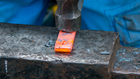forge: Detailed shot of metal being worked at a blacksmithing forge
