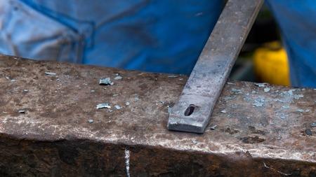 Detailed shot of metal being worked at a blacksmithing forge