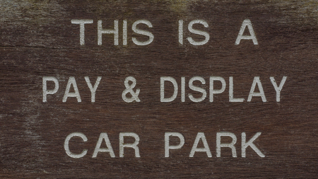 inscriptions: Pay and Display car parking sign